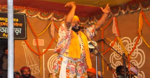 Baul singer performing at one of the Akhras